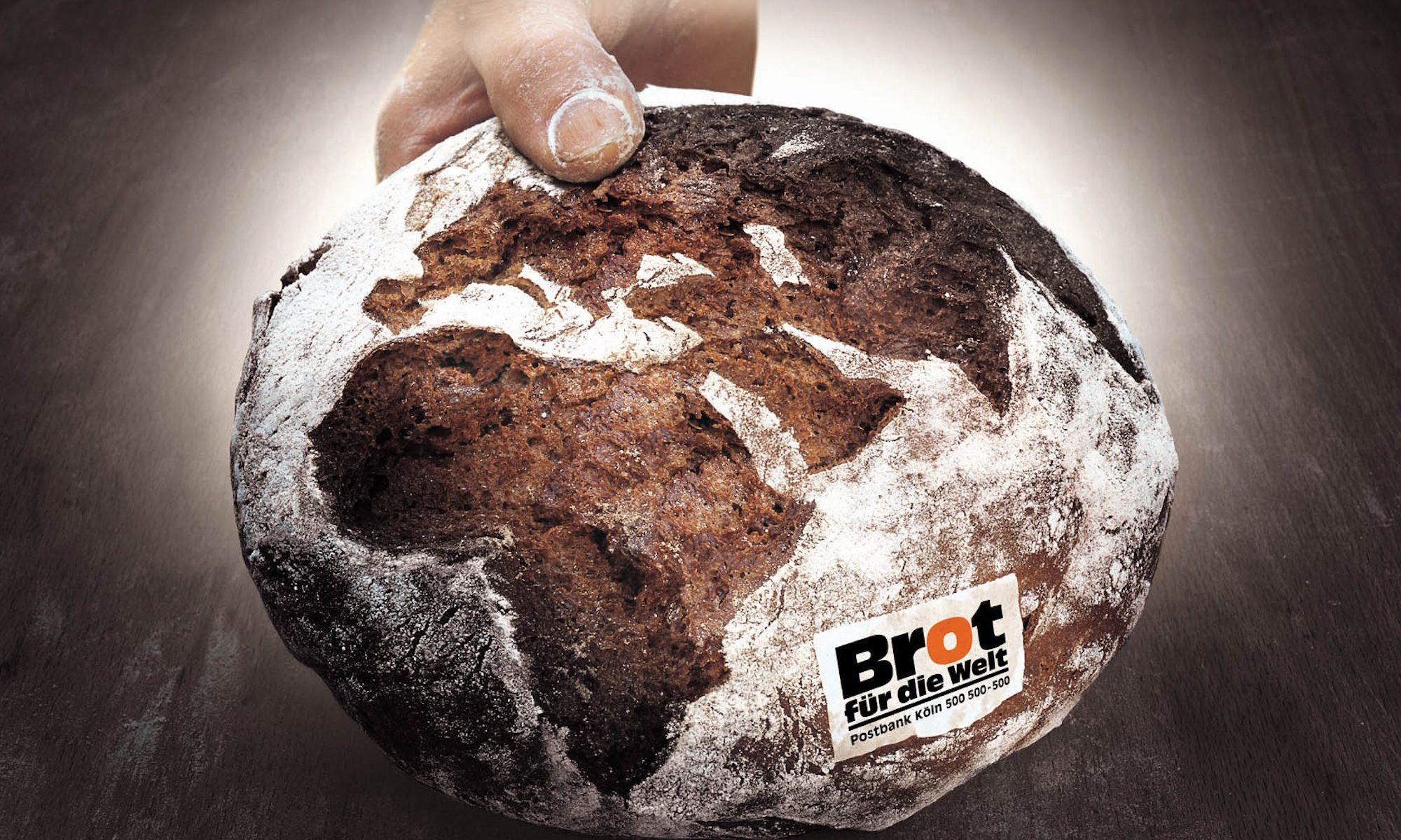 Ein Gutsherrenbrot, dessen Kruste in Form eines Globus aufgerissen ist.